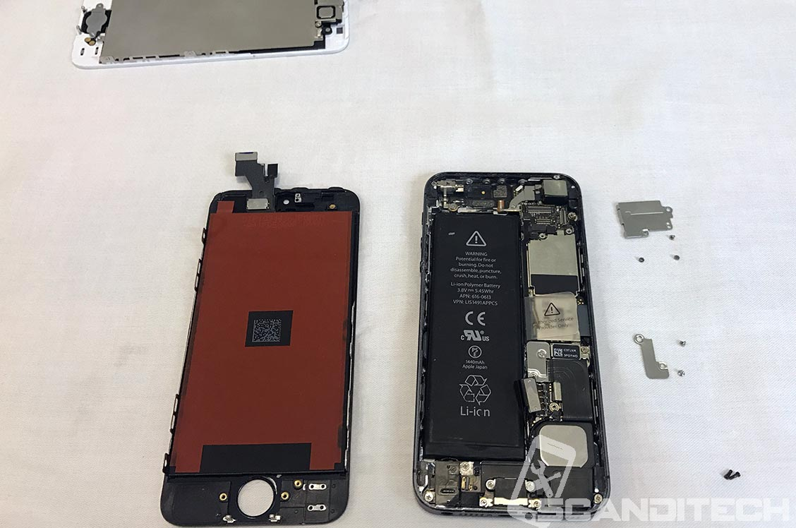 Old screen removed, new screen ready to be tested.