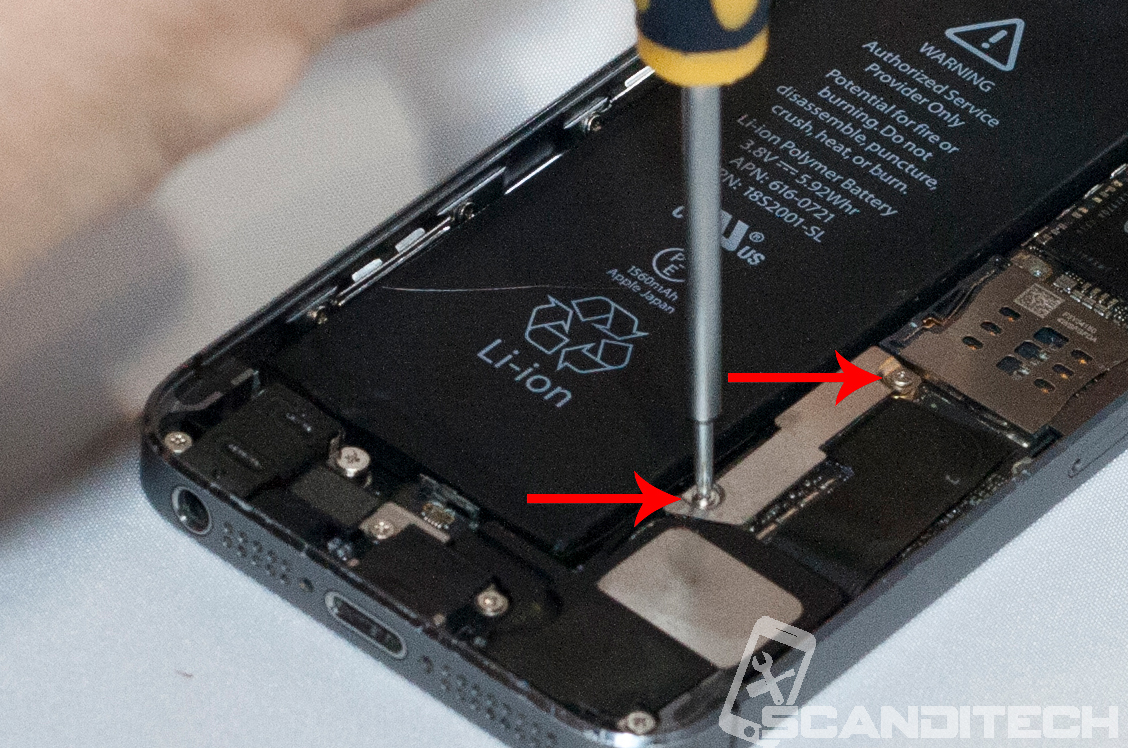 iPhone 5S/5C battery replacement guide - reinserting metal cover screws