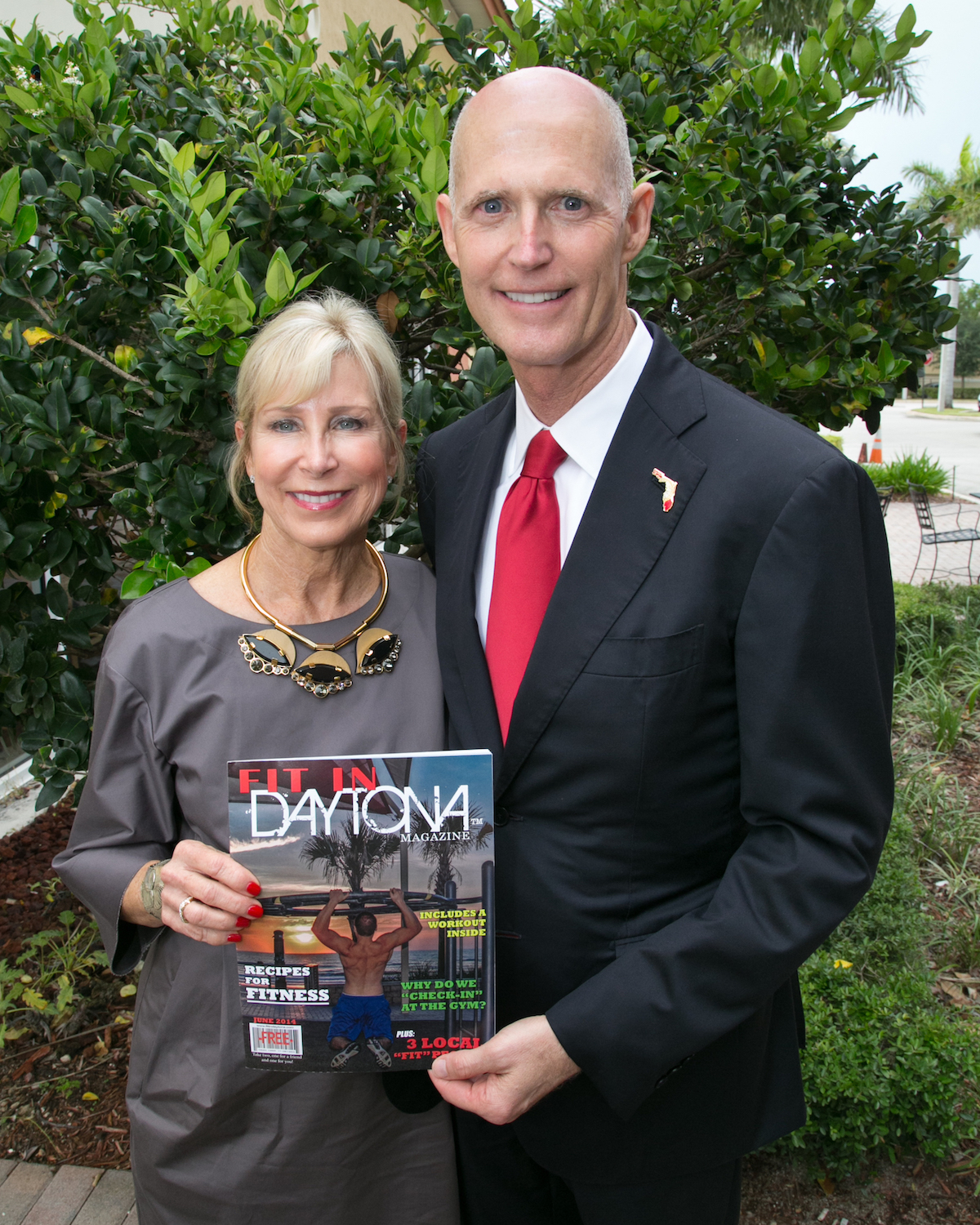 Governor Rick Scott and wife, Ann Scott with Fit in Daytona Magazine