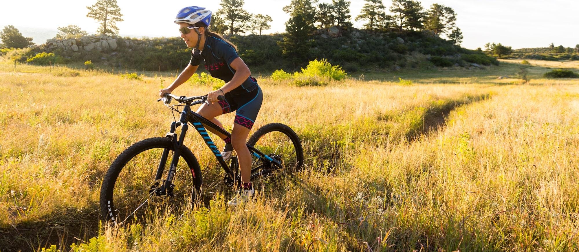 Professional mountain biker riding on a bike trail.