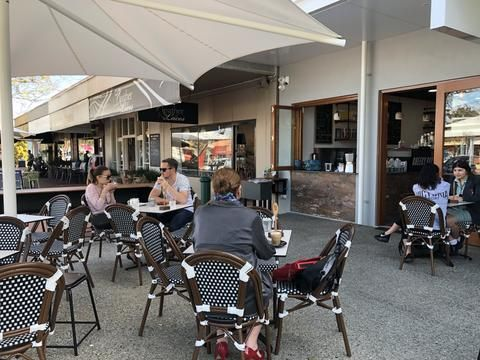 People sitting outside at a cafe