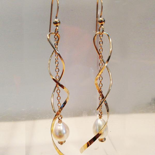 Custom made long gold swirl earrings with pearls