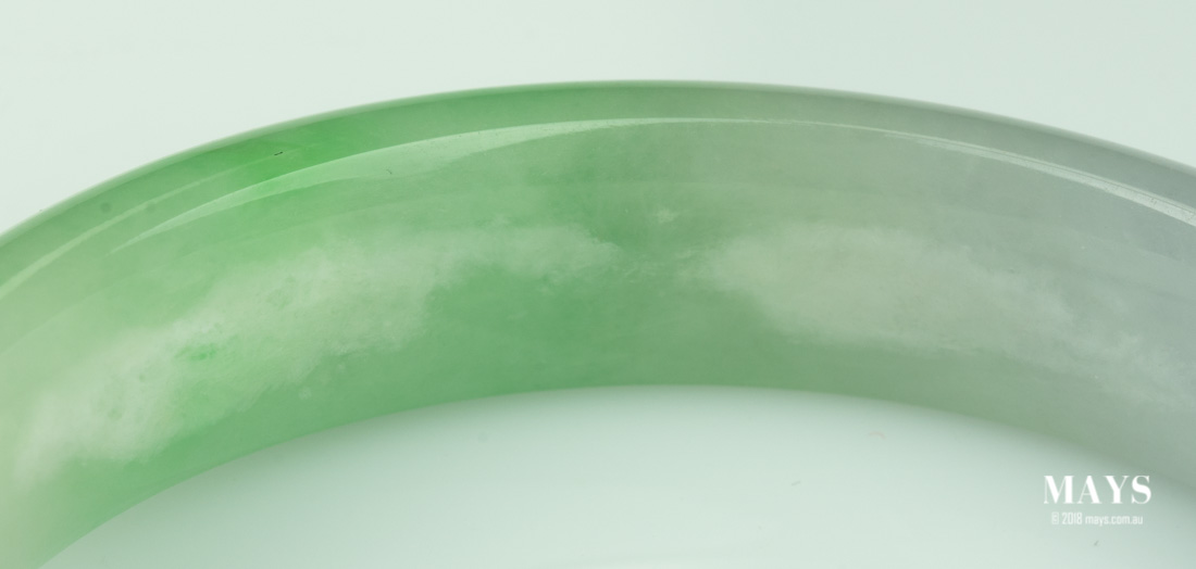 polymer impregnated jade bangle starting to show its voids