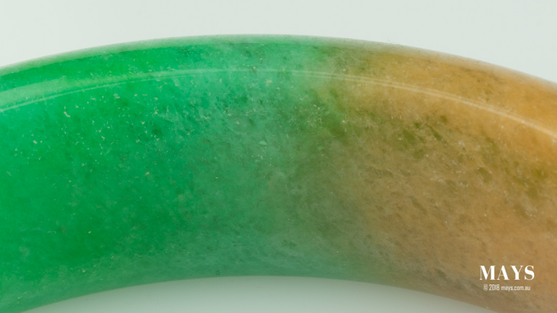 Polymer degradation visible in a treated jade bangle