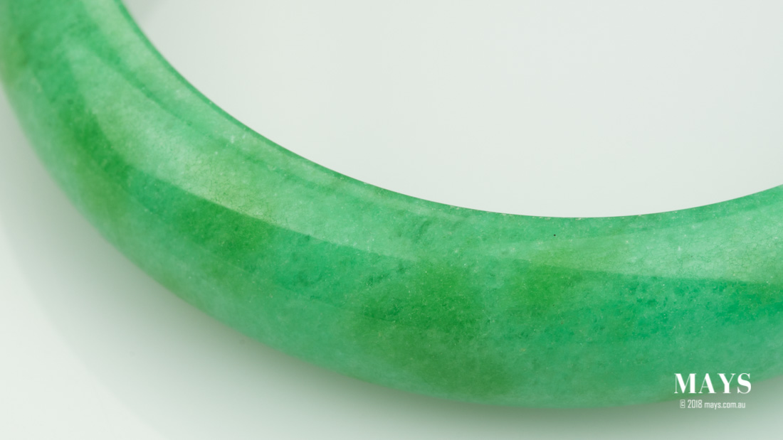 Dyes has become visible of a treated jade bangle