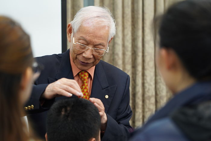 Dr Zhu applying needles