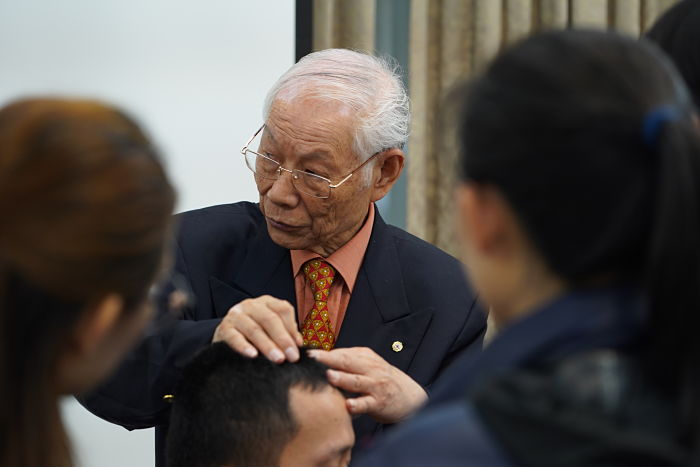 Dr Zhu applying needles