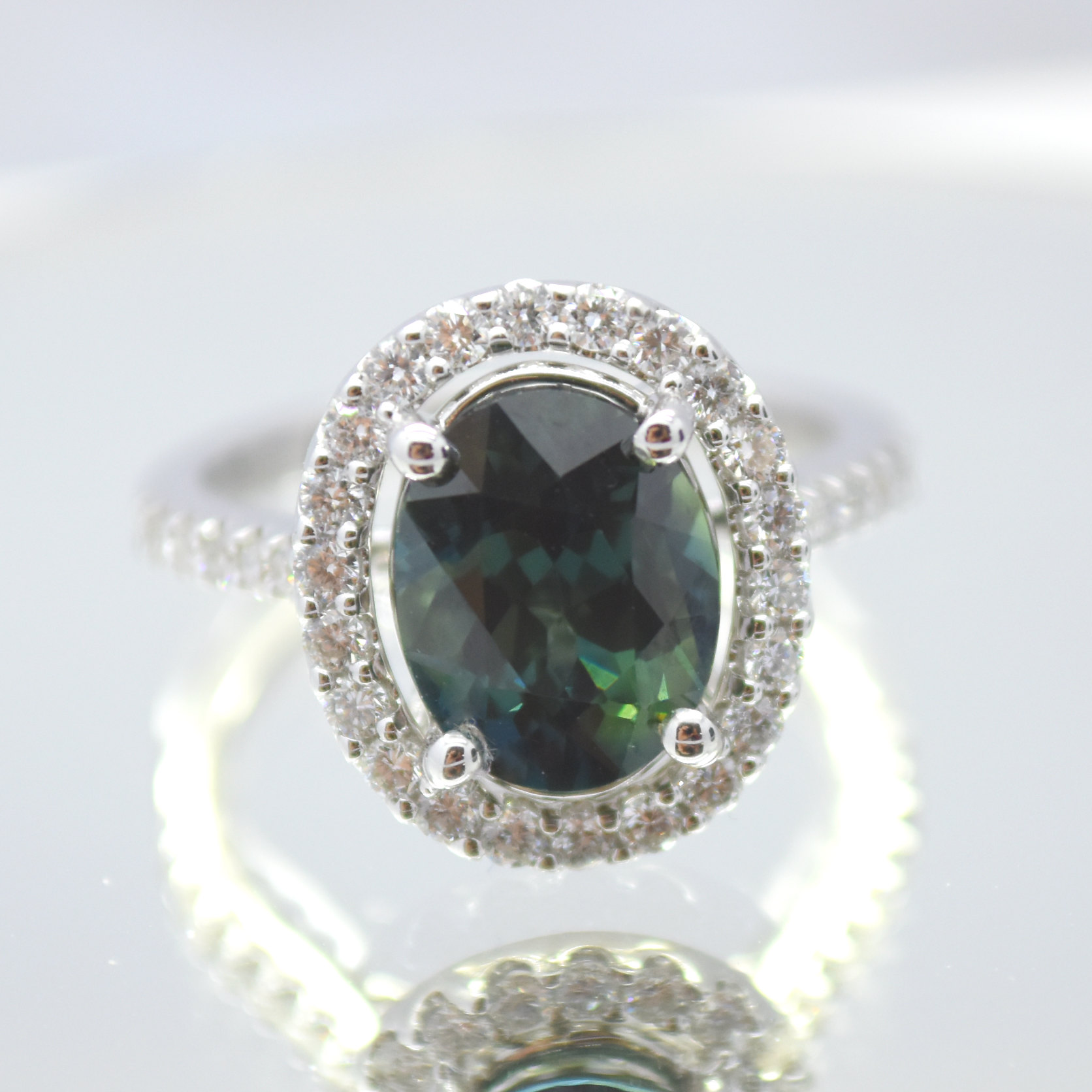 custom green sapphire diamond halo ring