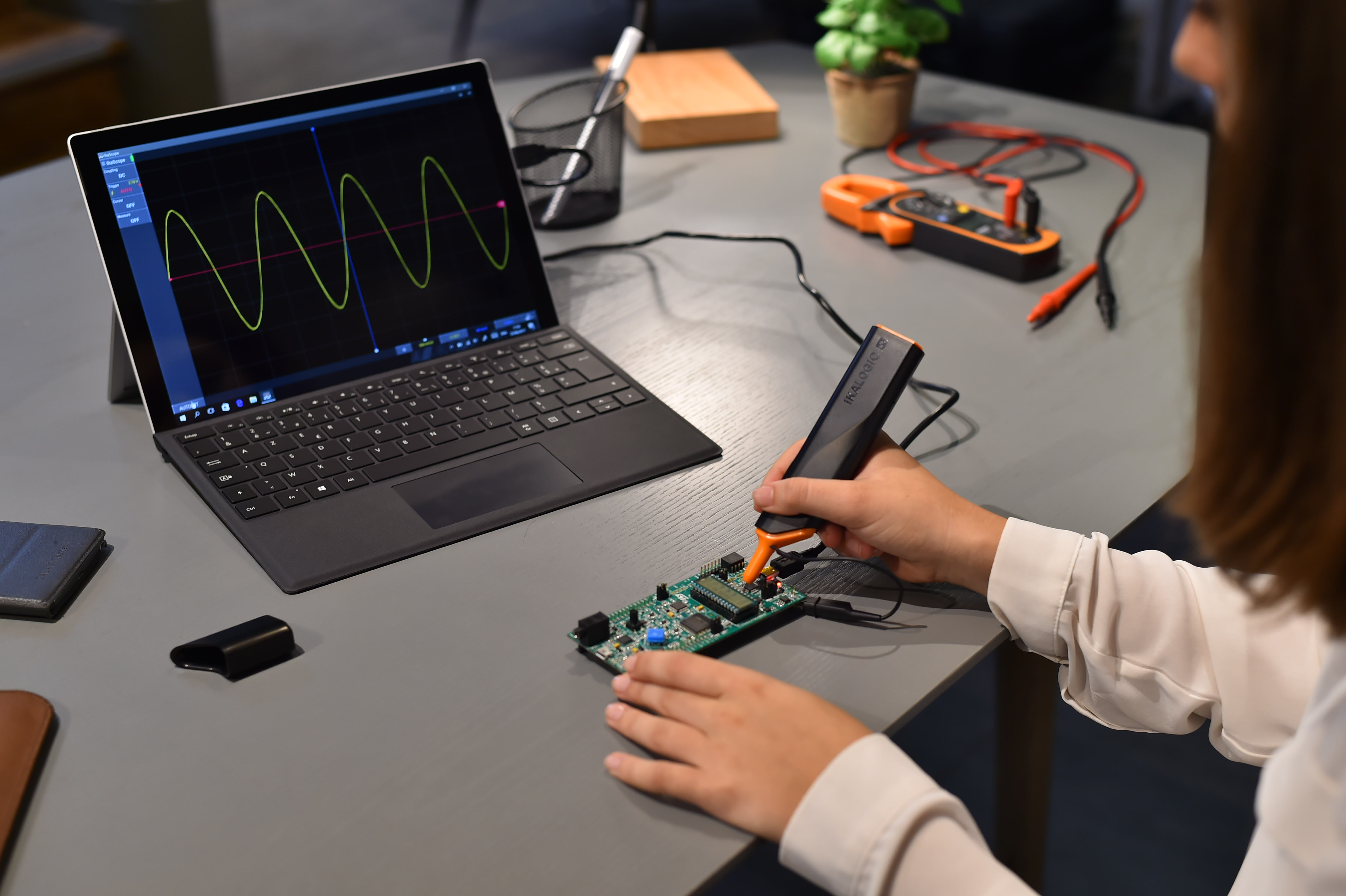 Engineer using IkaScope wireless oscilloscope