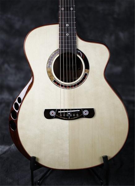 Guitare avec un Armrest muni d'évents