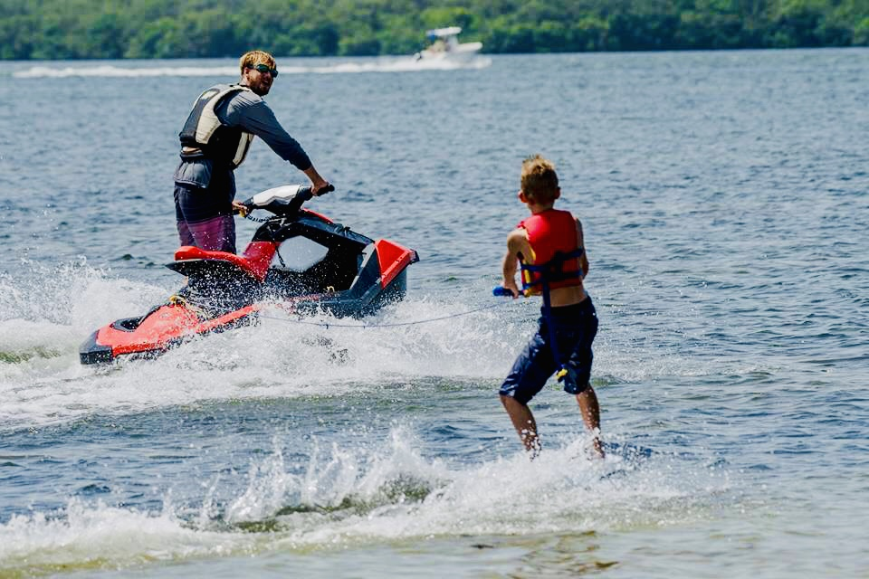 Jet Ski and kid wakeboarding