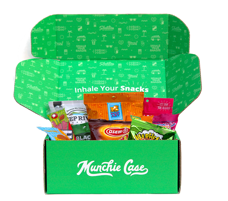 opened subscription box with mix of snacks filling inside the snack box