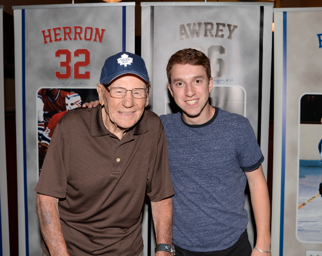President of CoJo Sport Collectables Cody Erlick posing with legend Johnny Bower at our public autograph signing in Toronto
