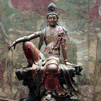 An ancient Chinese Buddha statue: Guanyin of the Southern Seas Time