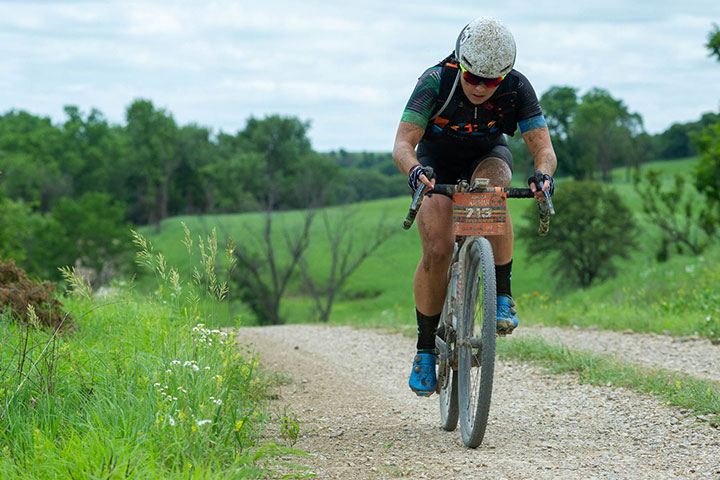 Amanda Nauman riding on a gravel path