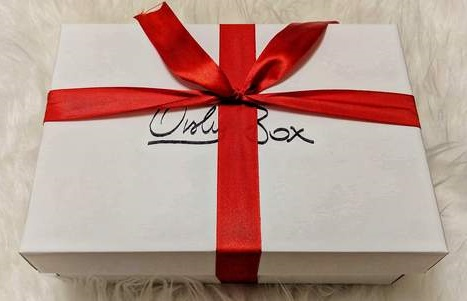 Orshy Box Wrapped in red ribbon