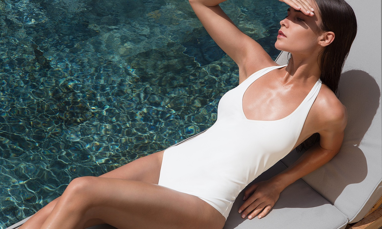 woman with a white swimsuit at the pool
