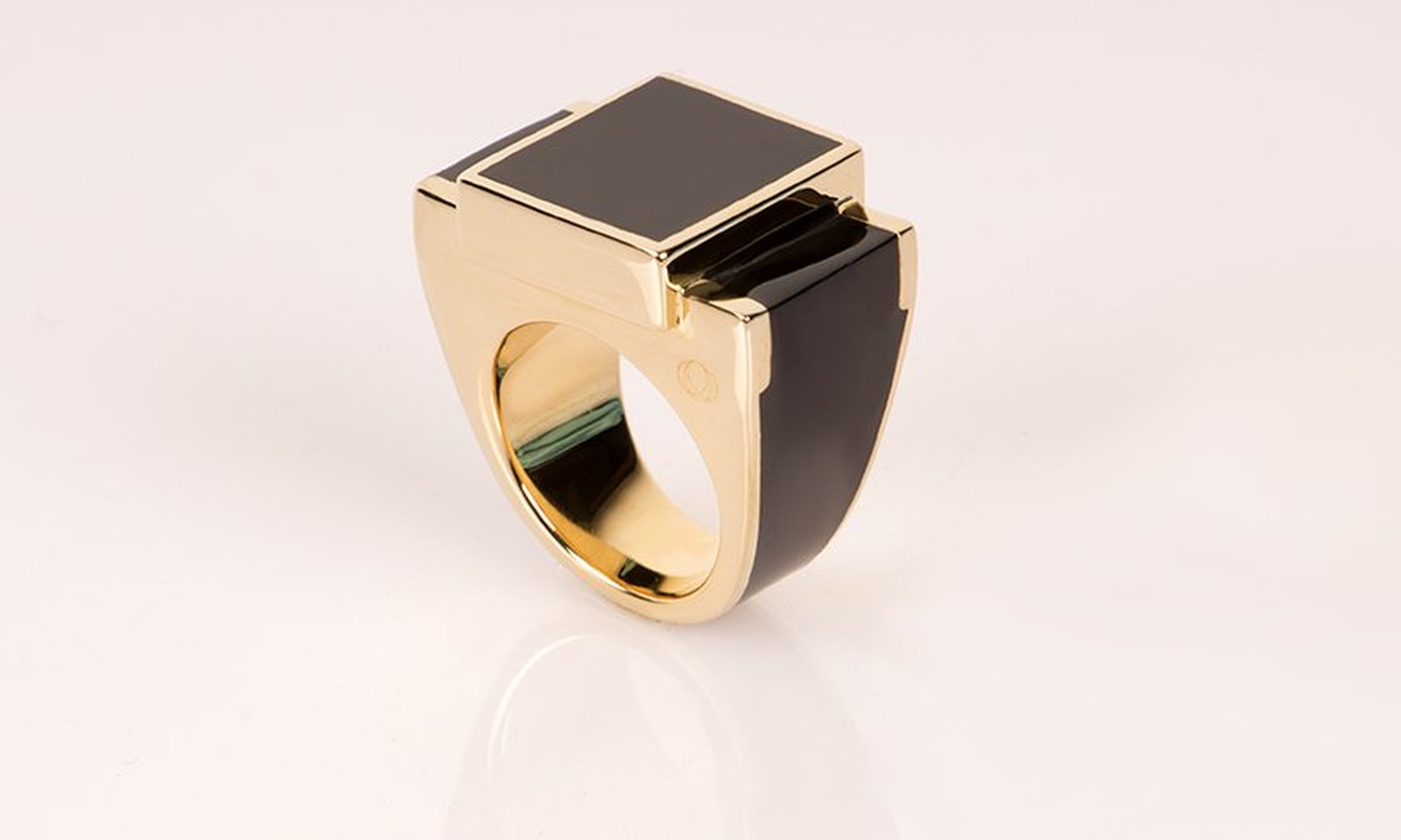 gold ring in black by The Rose