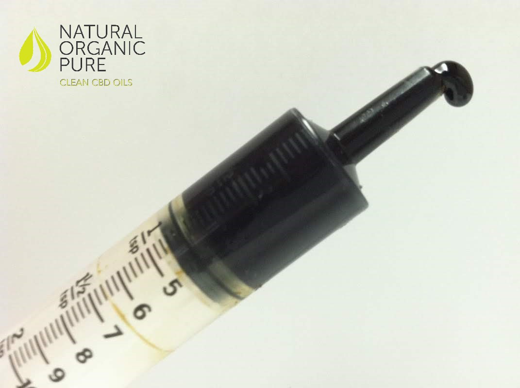 close up of full spectrum organic cbd concentrate paste syringe_cbd paste syringe by natural organic pure clean cbd oils