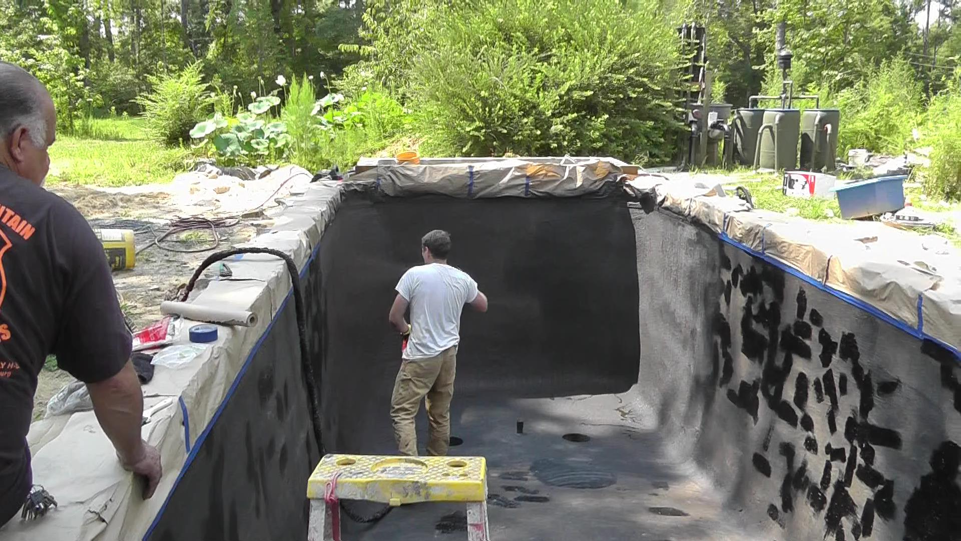 spraying Dura-Rubber liquid rubber for Koi ponds