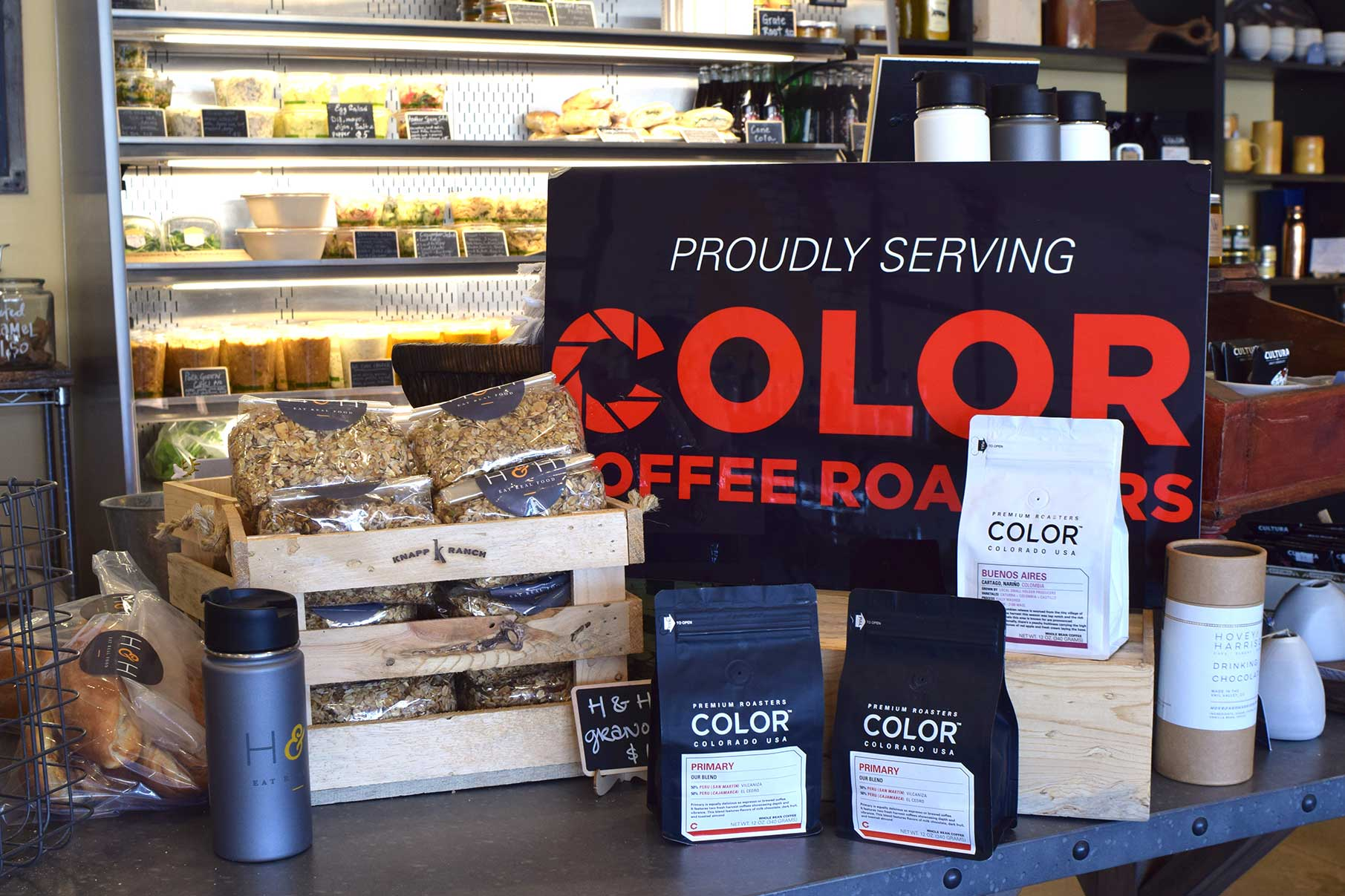 Proudly Serving Color Coffee Roasters Sign and Display
