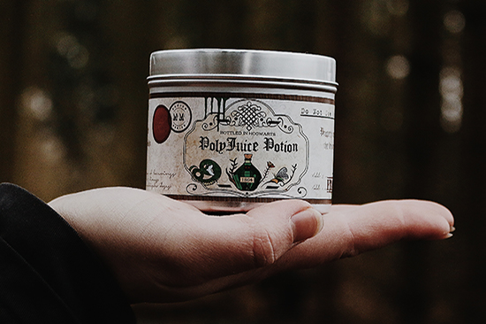 Polyjuice Potion scented candle in a hand.