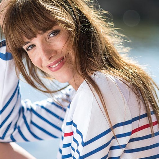 Woman smiling with French stripes