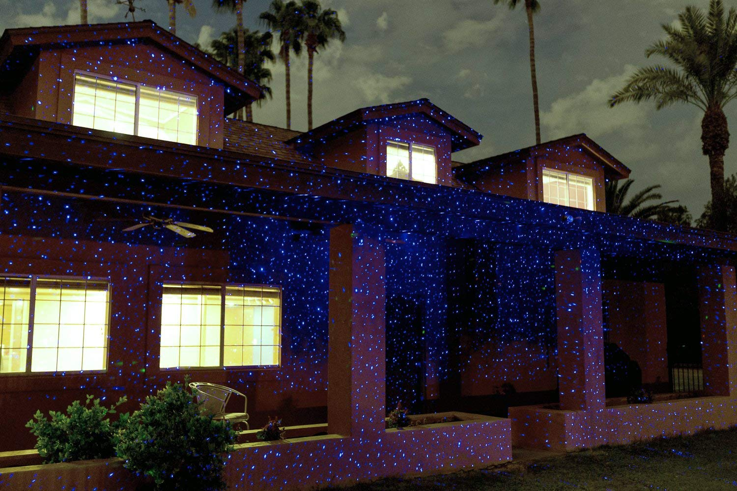 Blue Sparkle Magic Laser Light on House at Night