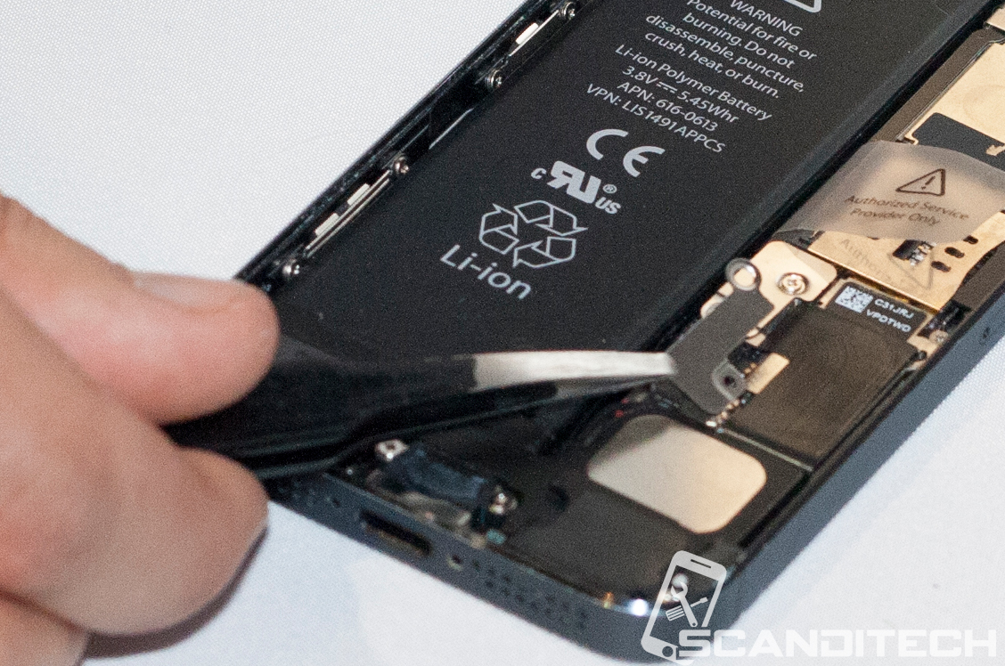 iPhone 5 battery replacement guide - Removing the battery metal cover.